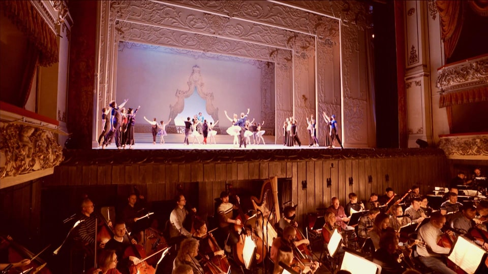 The dancers on stage and the orchestra in the pit.