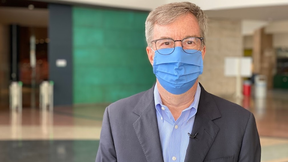 Jim Watson wearing a mask in Ottawa City Hall.