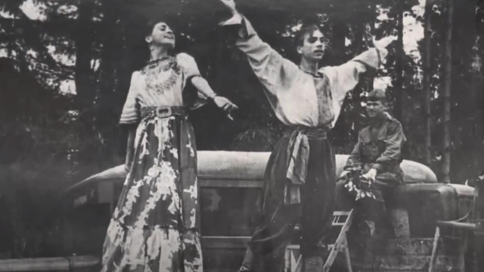 A black and white photo of dancers.