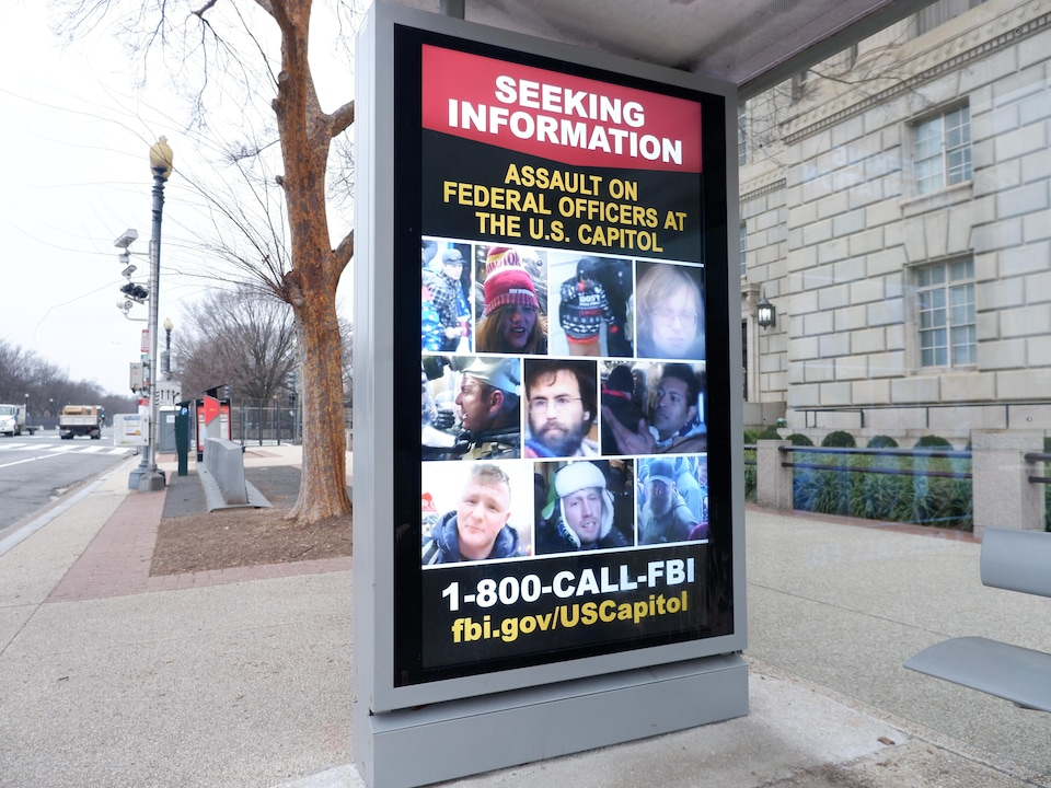 An FBI wanted poster in a Washington bus shelter.