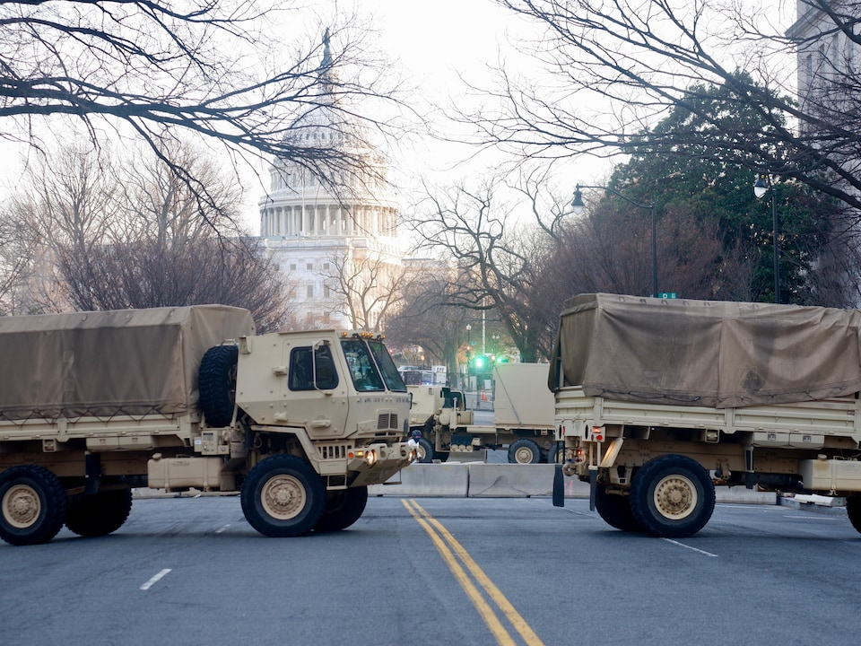 National Guard trucks in front of the Capitol.