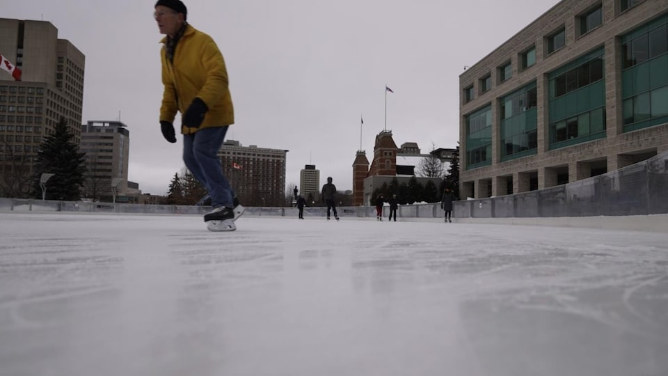 People skate on an outdoor rink in Ottawa.