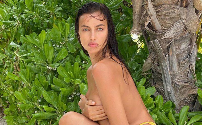 Irina Shayk wears yellow bikini bottoms and sandals